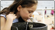 Girl Drinking Water From Water Fountain