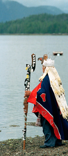 Man In Ethnic, Traditional Clothing Looking Over A Lake