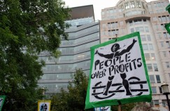 "Sign outside World Bank that reads ""People Over Profits"""