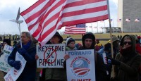 Citizens brave the cold to protest further work on the Keystone XL Pipeline, Forward on Climate March, Feb 2014.