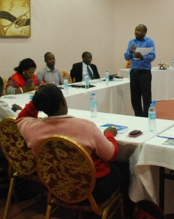 John Mwebe speaks to participants at the training