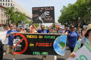 "CIEL staff at People's Climate March, holding signs saying ""There's no future in fossil fuels."""